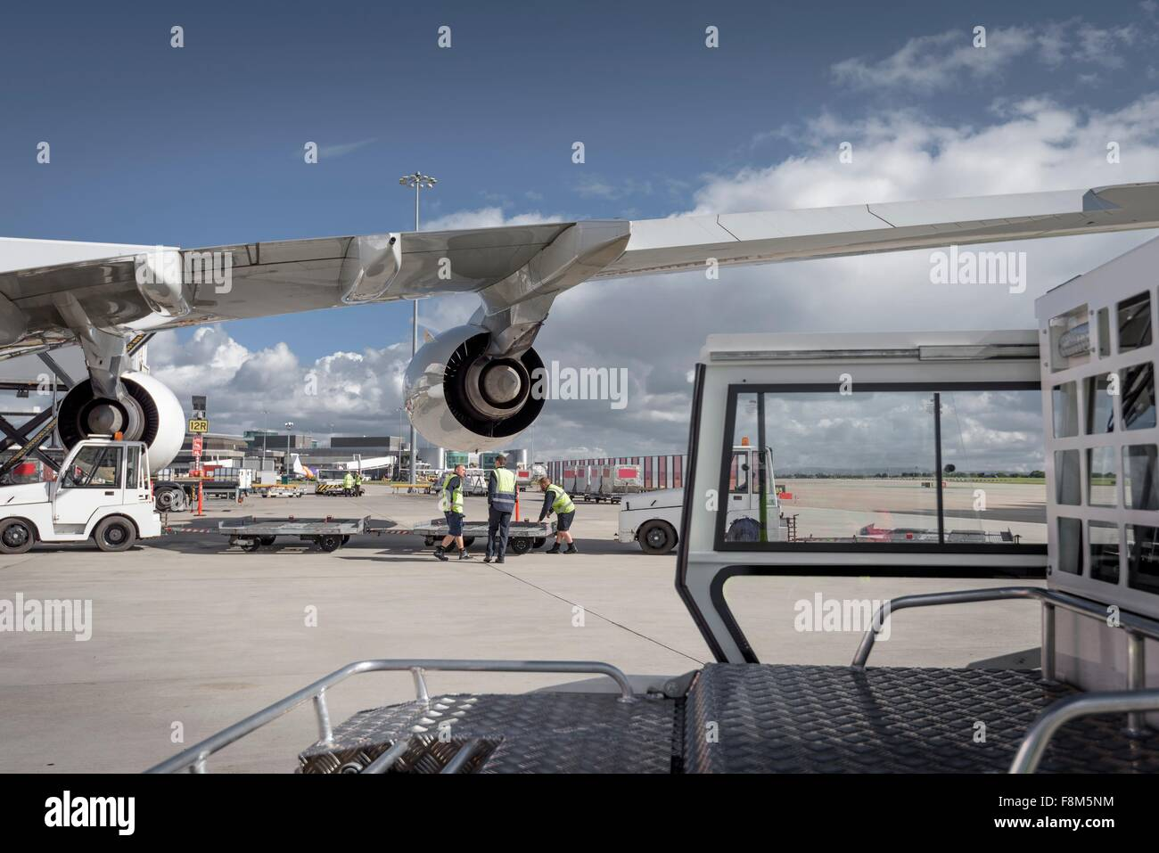 Ground crew loading A380 jet aircraft at airport - Stock Image