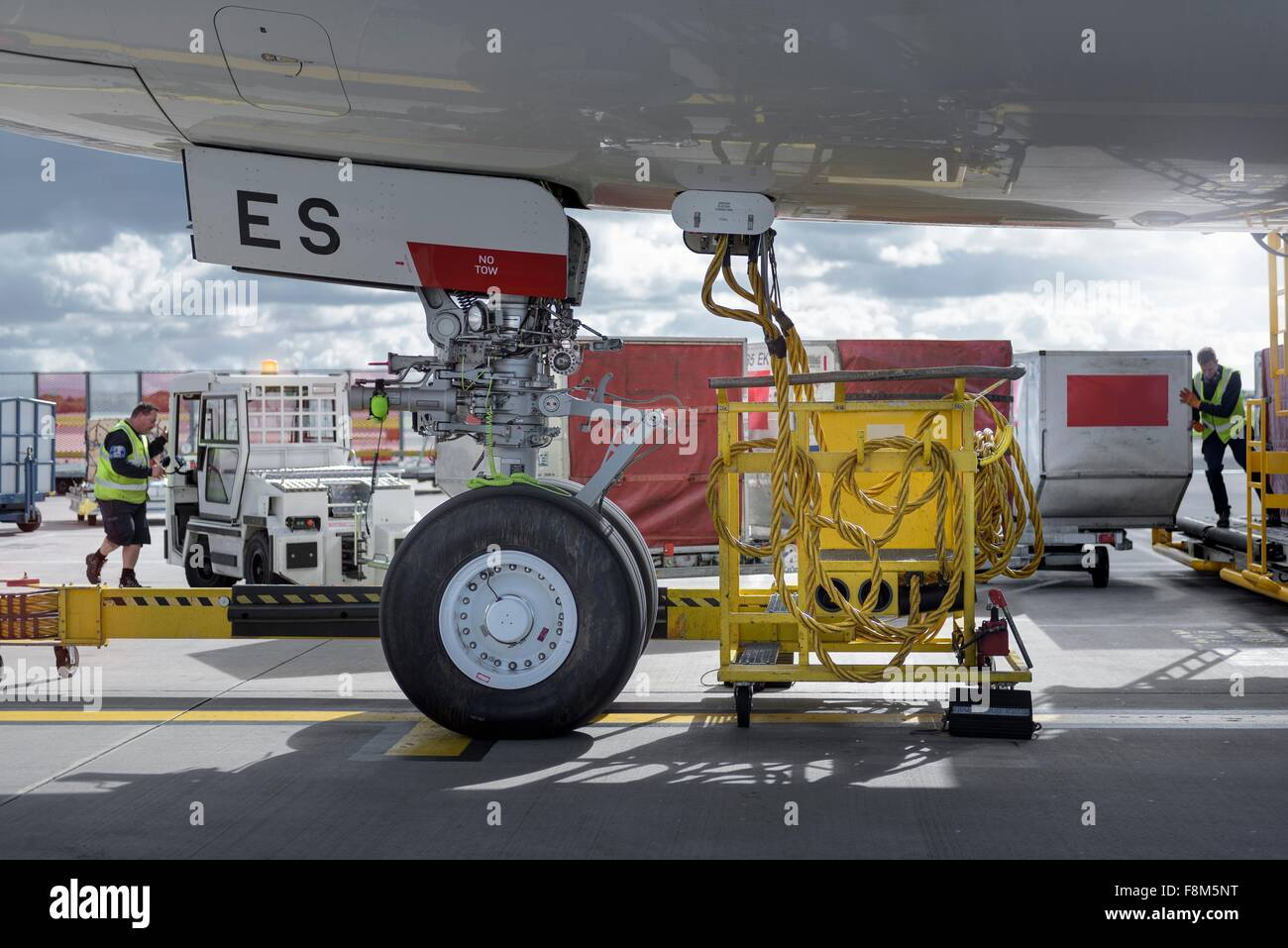 Ground crew loading luggage into A380 aircraft - Stock Image