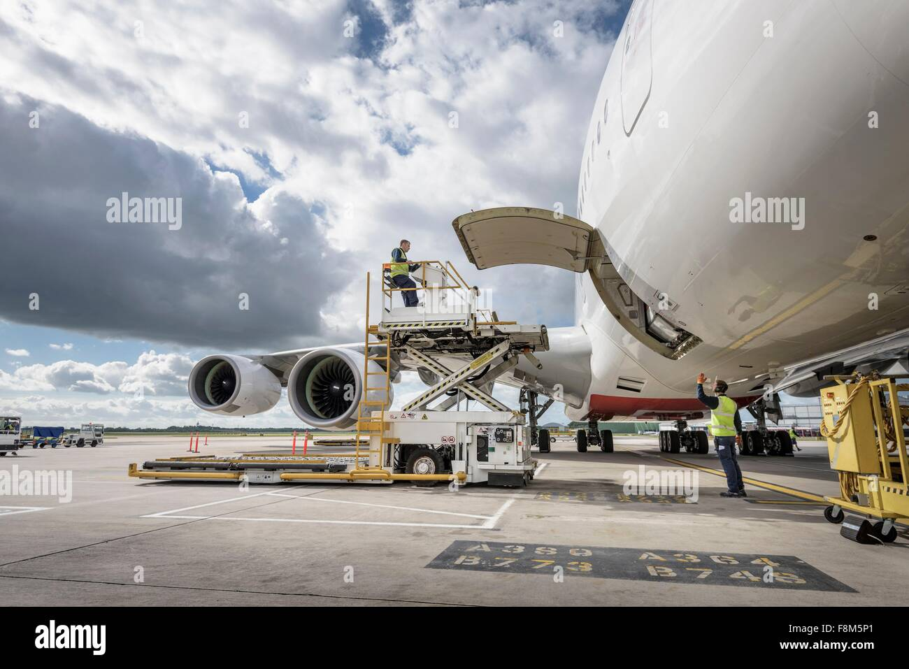 Freight handling machinery with A380 aircraft - Stock Image
