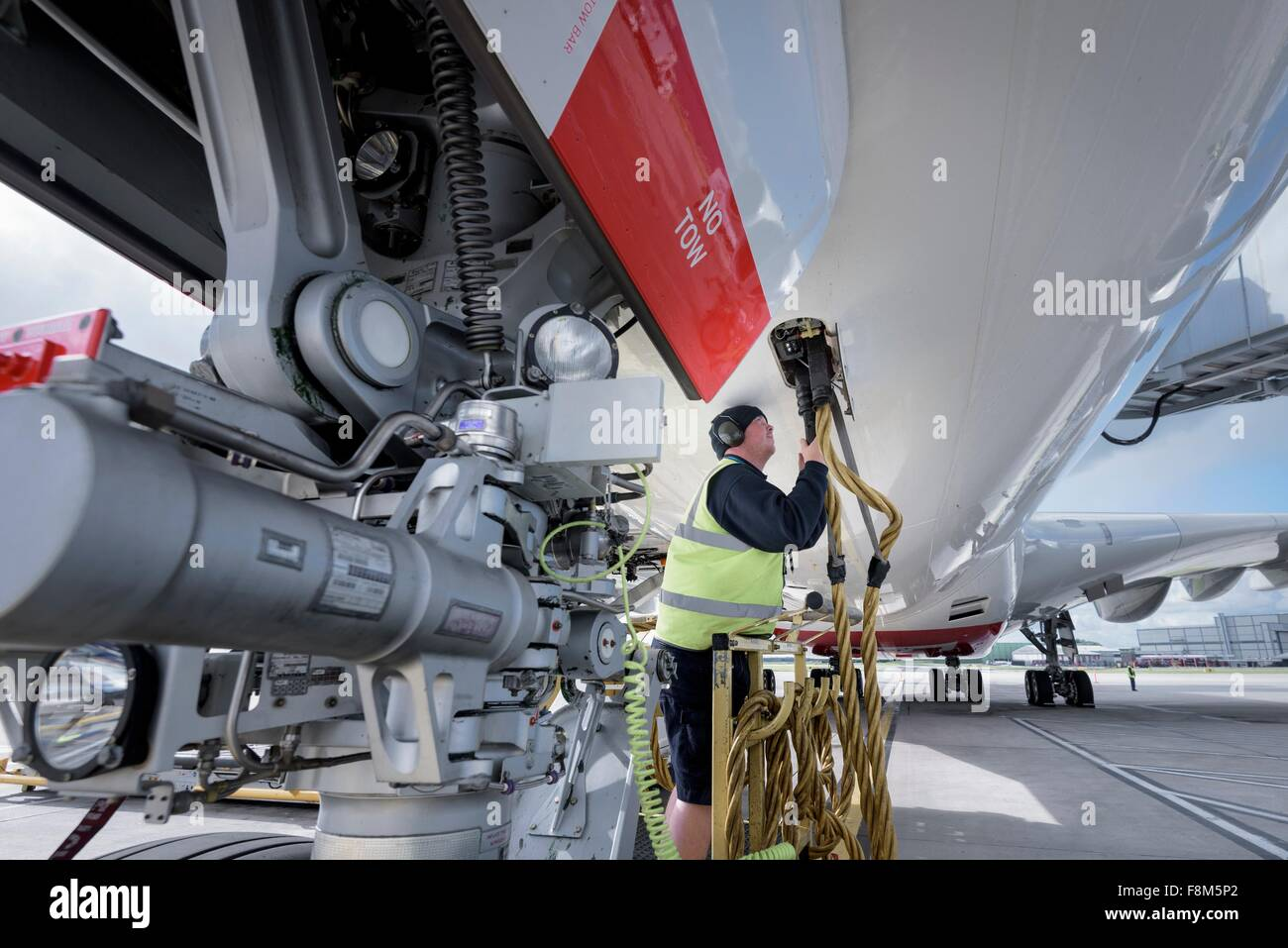 Ground crew service worker with A380 aircraft - Stock Image