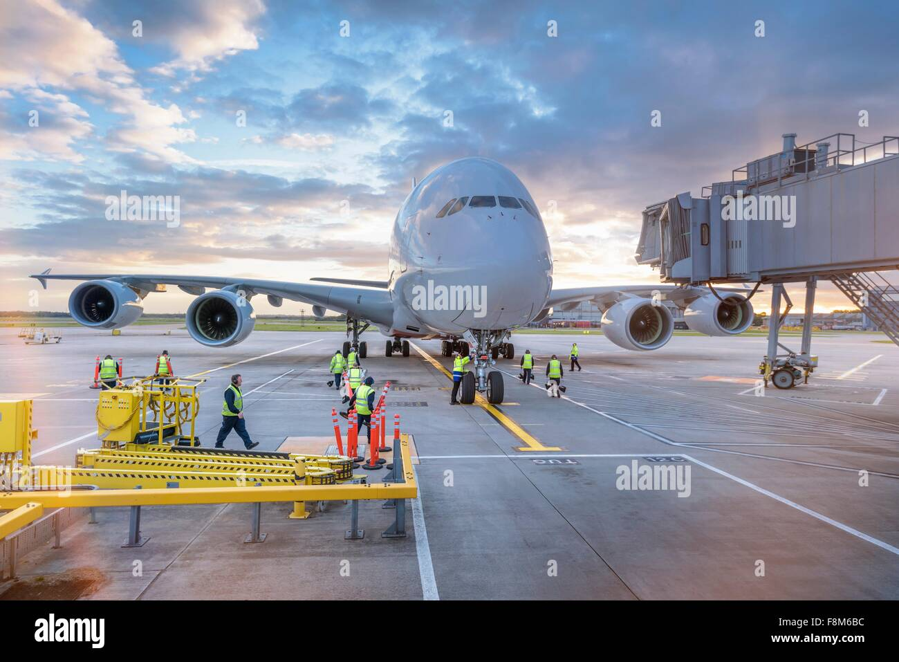Ground crew attending to A380 aircraft at airport - Stock Image