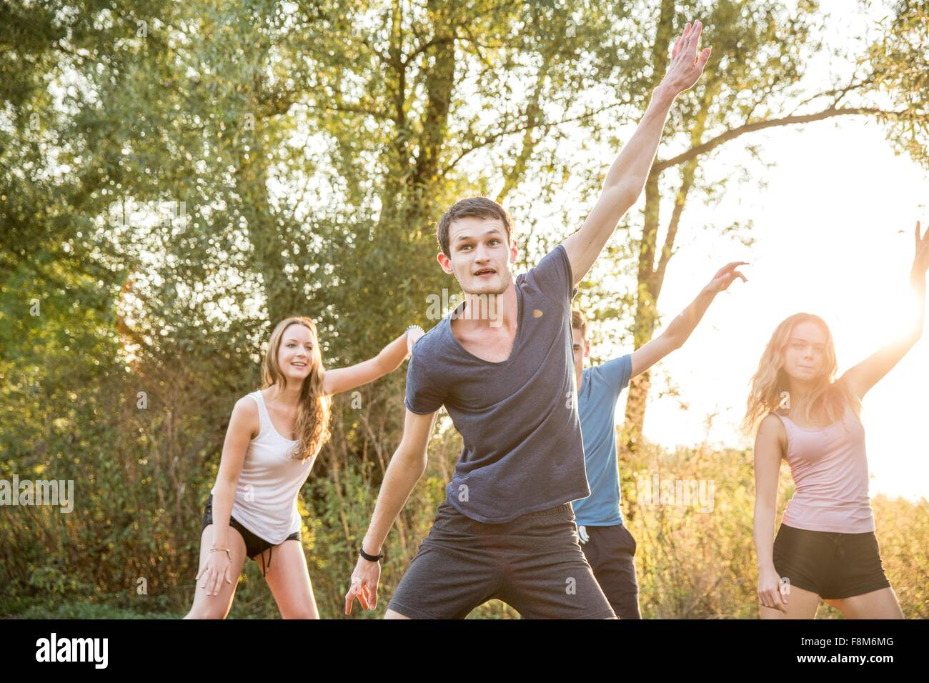 Group of friends exercising in rural environment - Stock Image