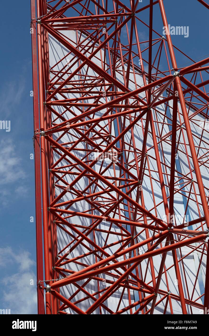 Red framework structure with textile against blue sky - Stock Image