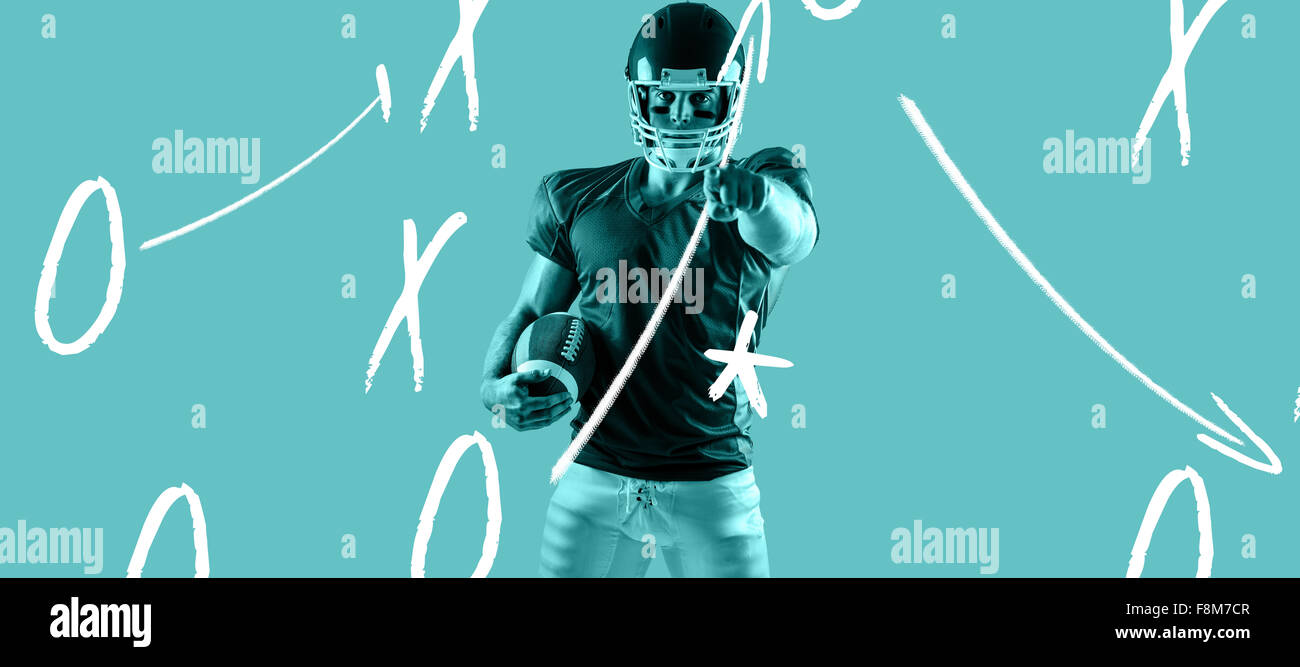 Composite image of american football player pointing at camera - Stock Image
