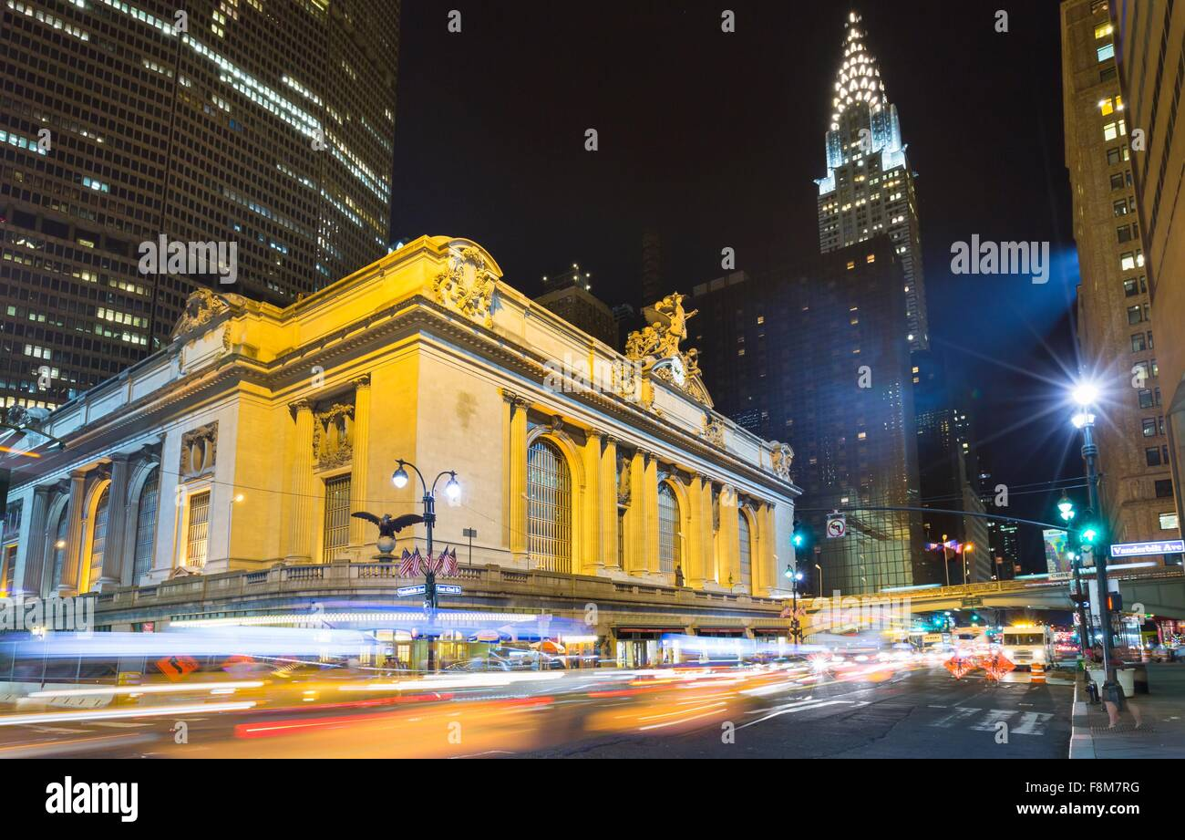 Busy traffic and Grand Central Station at night, New York, USA - Stock Image