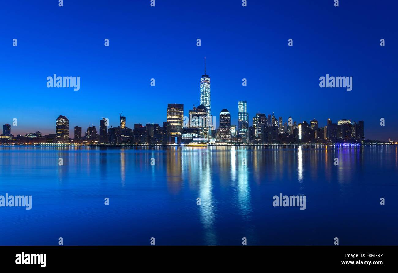 Manhattan financial district skyline and One World Trade Centre at night, New York, USA - Stock Image