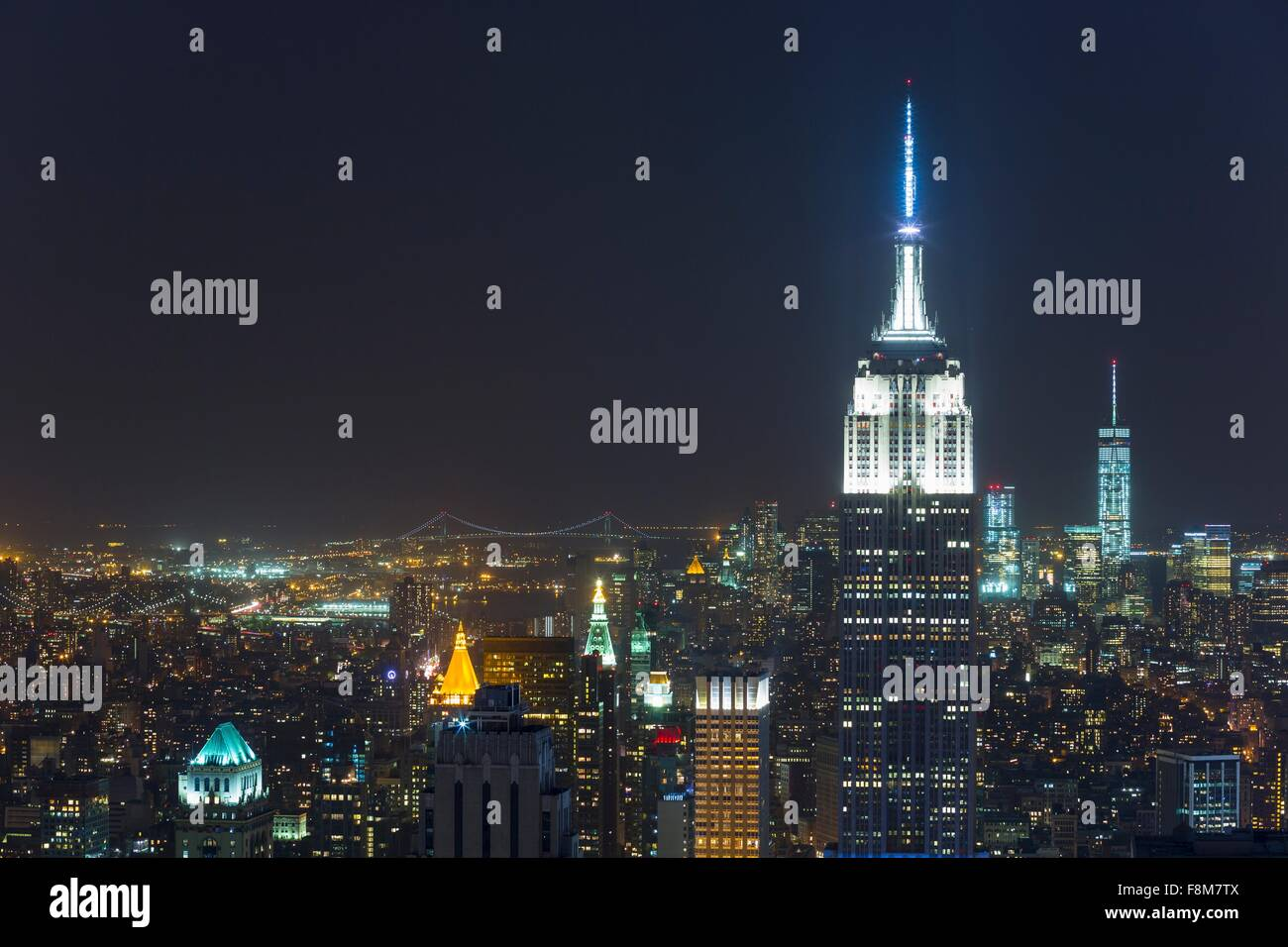 High angle cityscape of midtown Manhattan and Empire State building at night, New York, USA - Stock Image