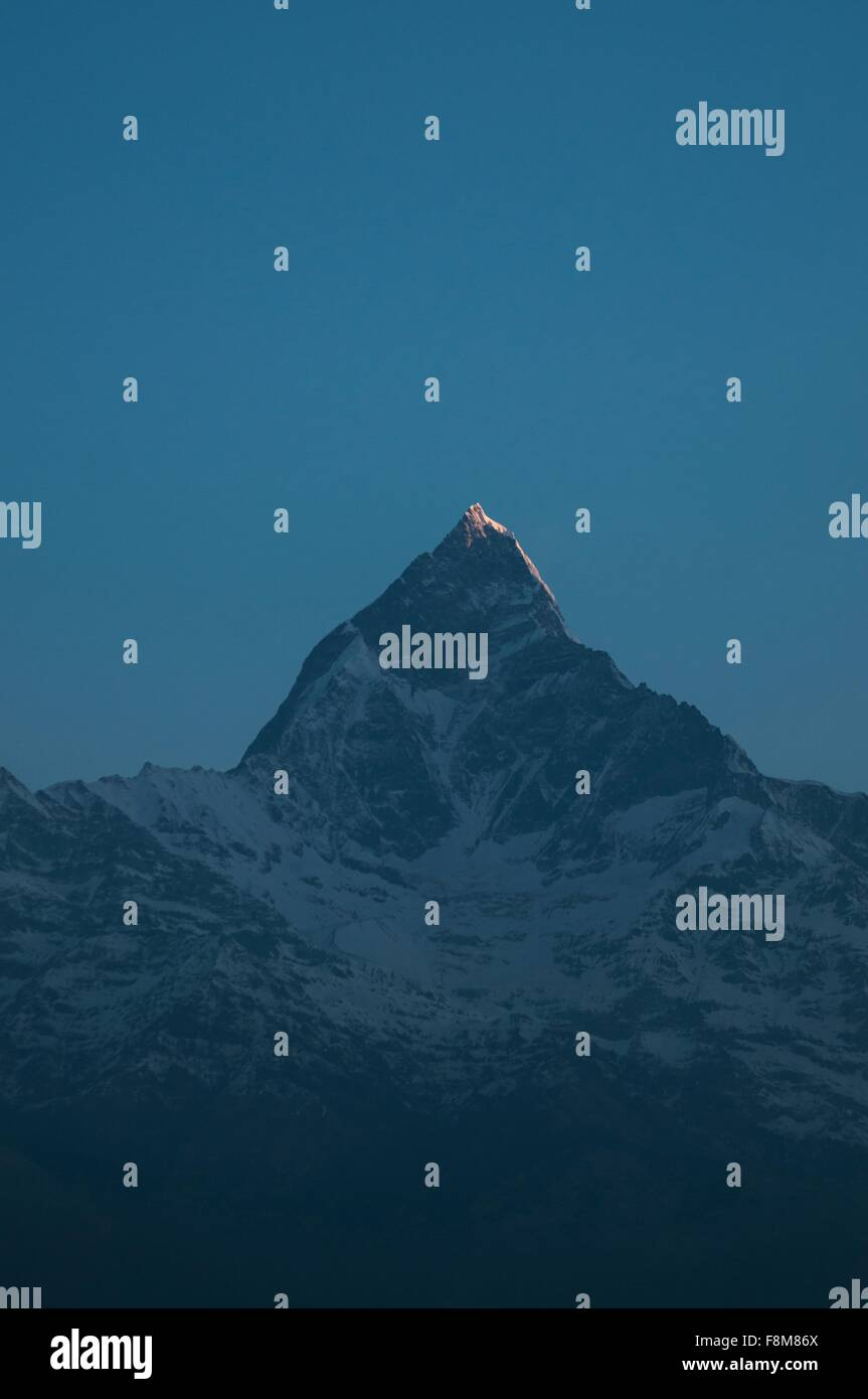 Snow capped mountain in darkness, Nepal - Stock Image