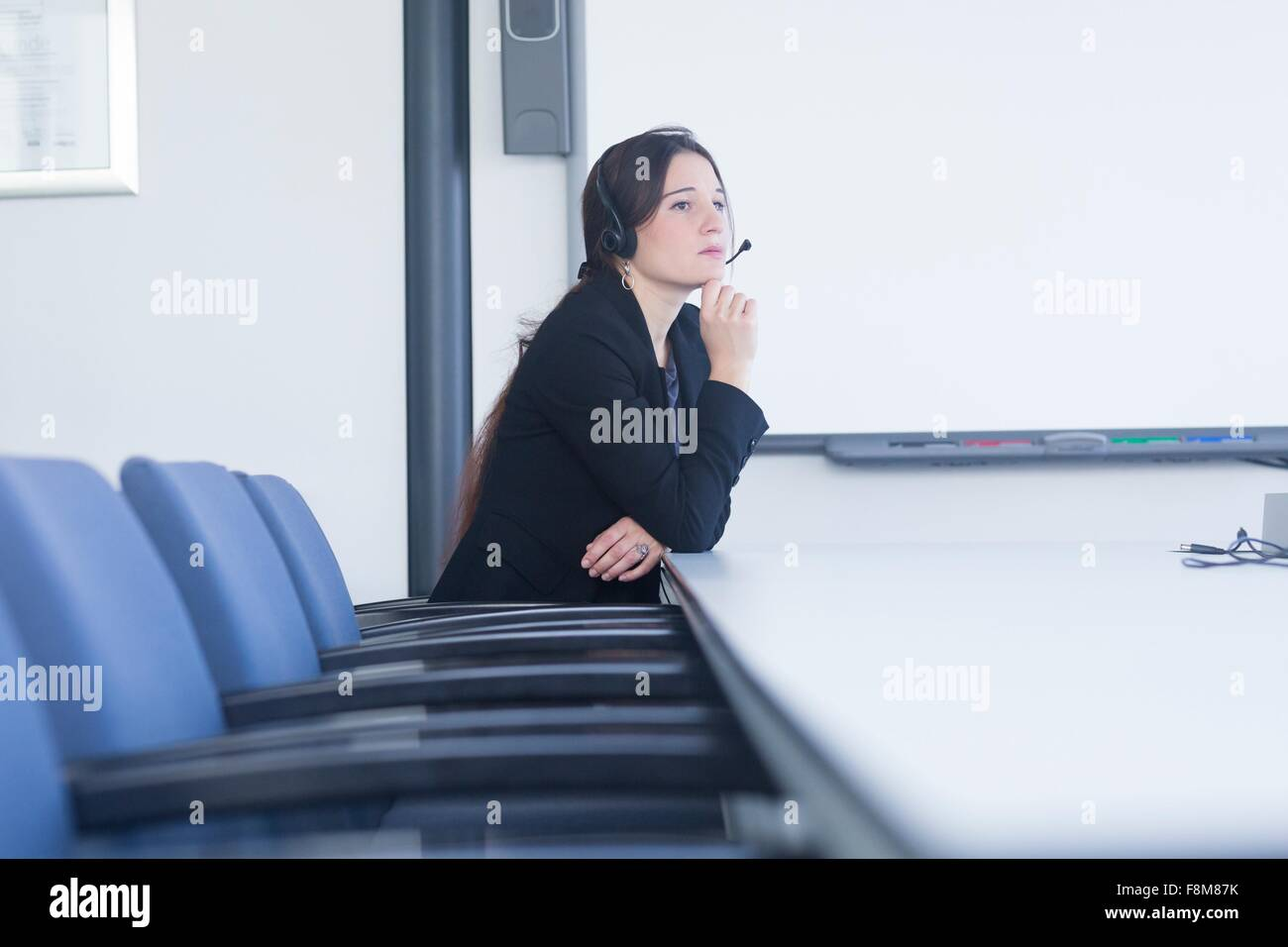 Telephonist contemplating in meeting room Stock Photo