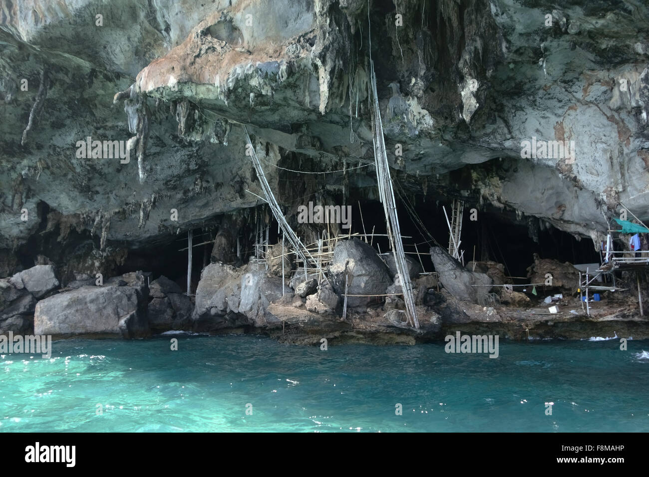 Cave on Koh Hong island with equipment for harvesting nests of edible-nest swiflets, Thailand - Stock Image