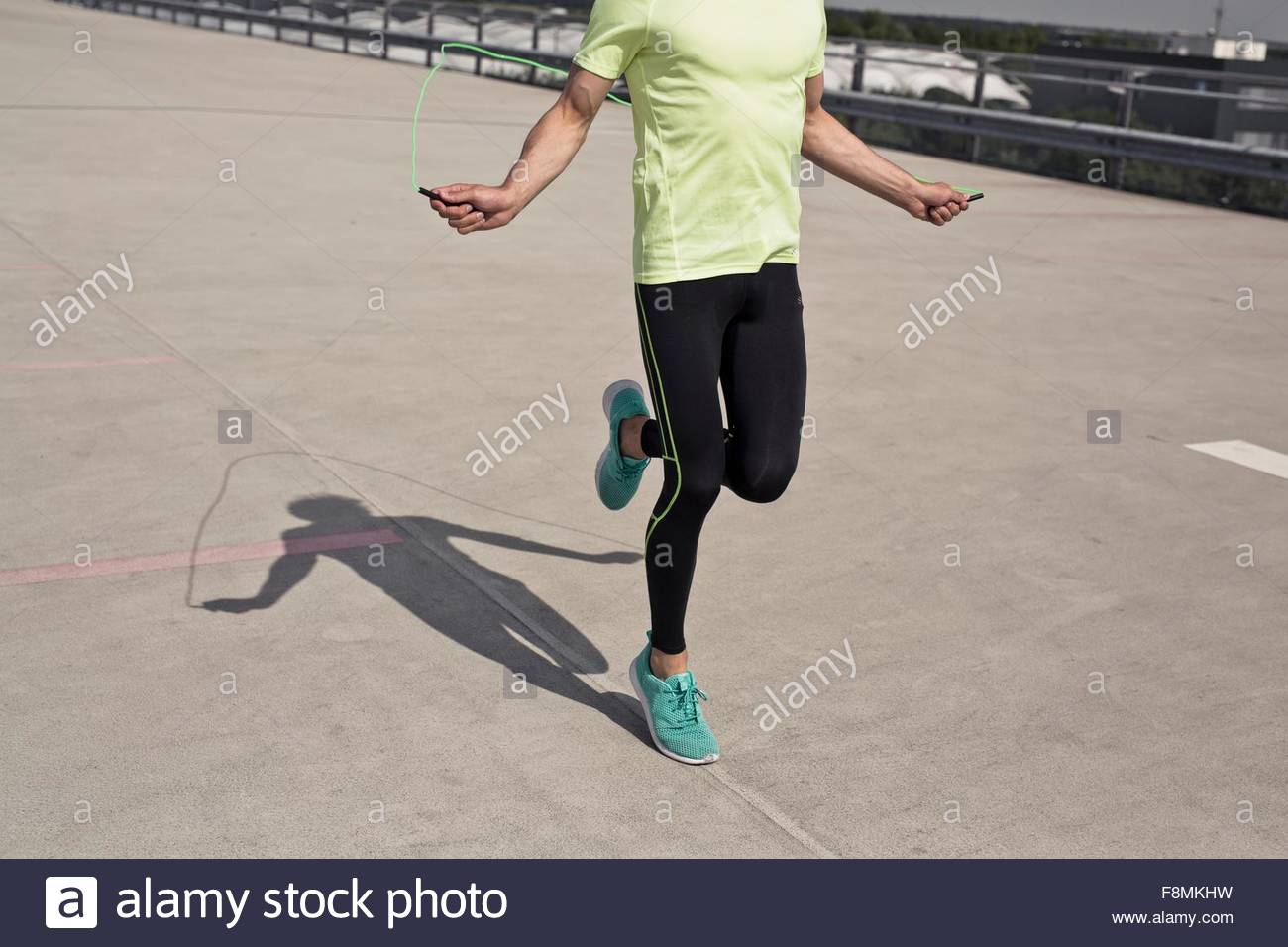 Young man doing skipping training in city - Stock Image