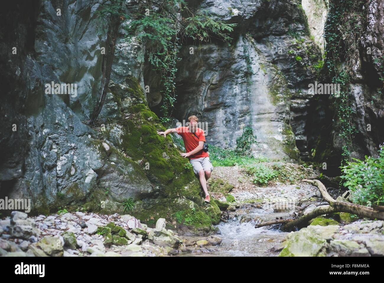 Man exploring rock formation, Garda, Italy - Stock Image
