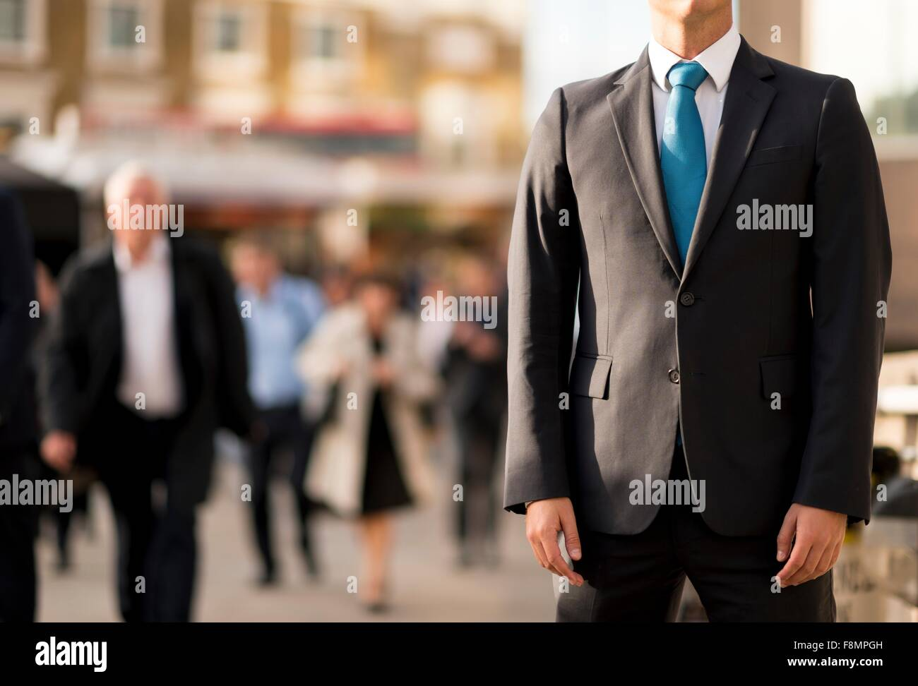 Businessman in suit, partially obscured, London, UK - Stock Image