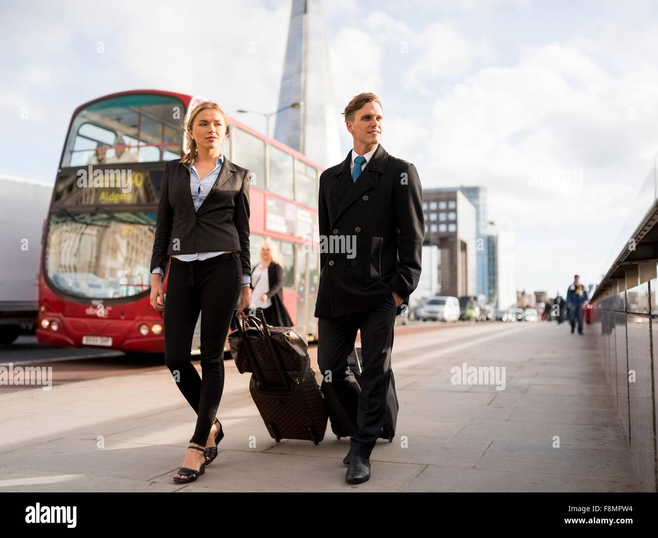 Businessman and businesswoman on business trip, London, UK Stock Photo