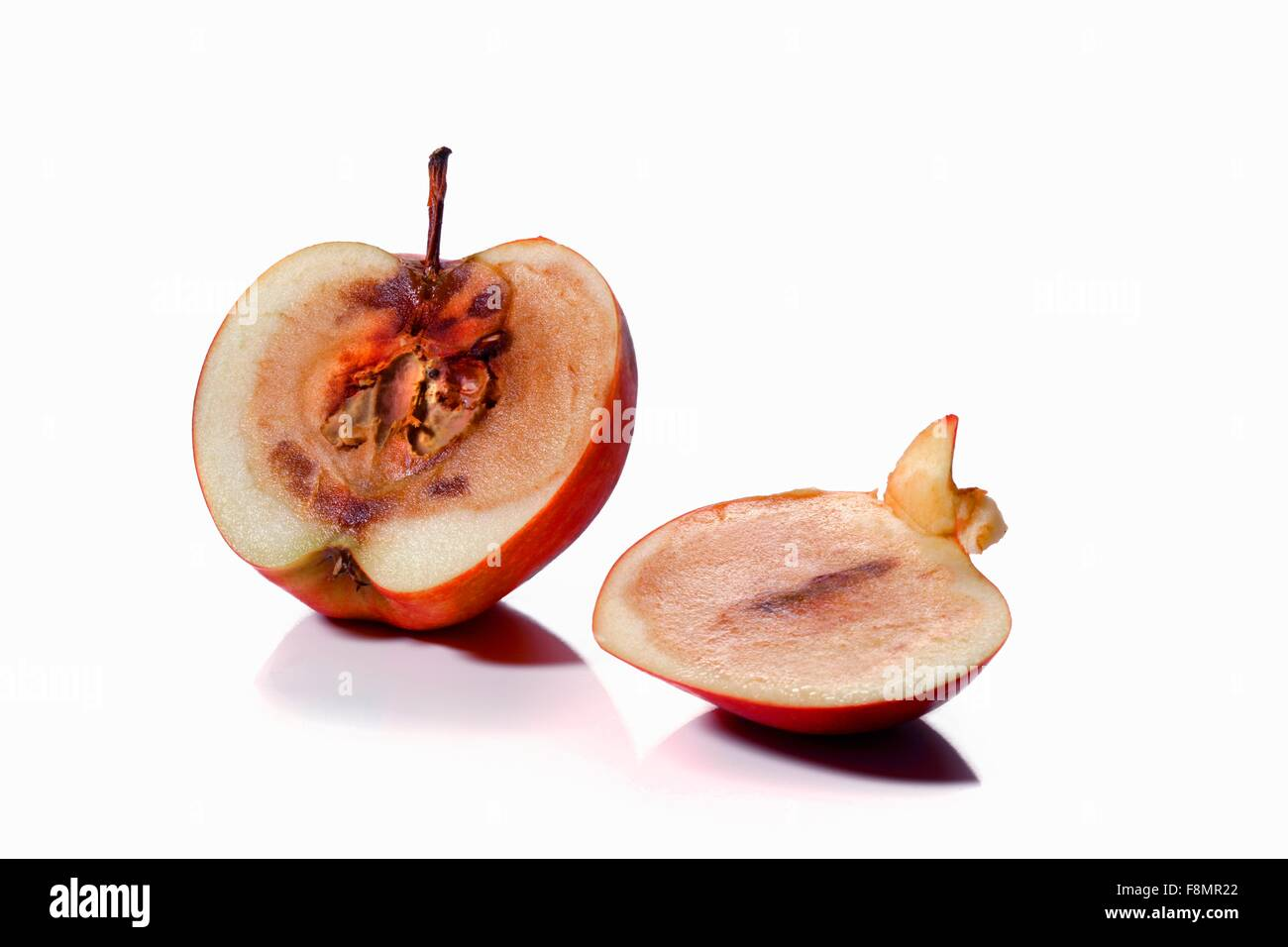 A mouldy apple, sliced - Stock Image