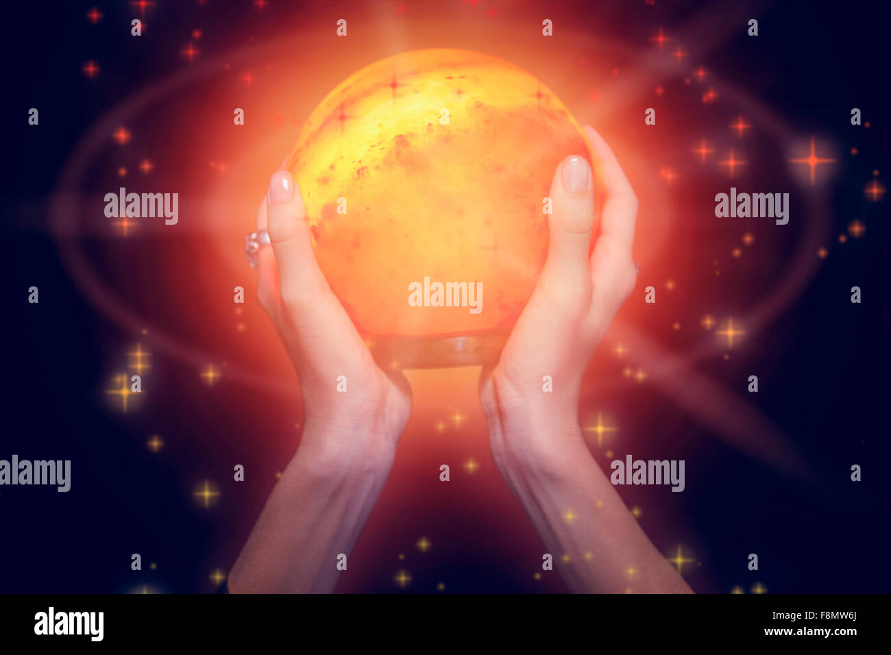 Composite image of fortune teller holding crystal ball - Stock Image