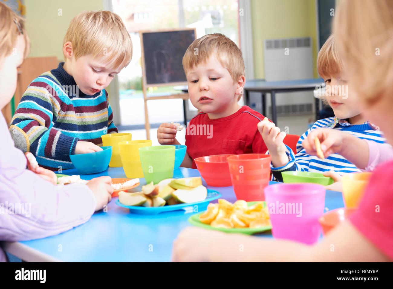 Pre School Children Eating Healthy Snacks At Breaktime ...