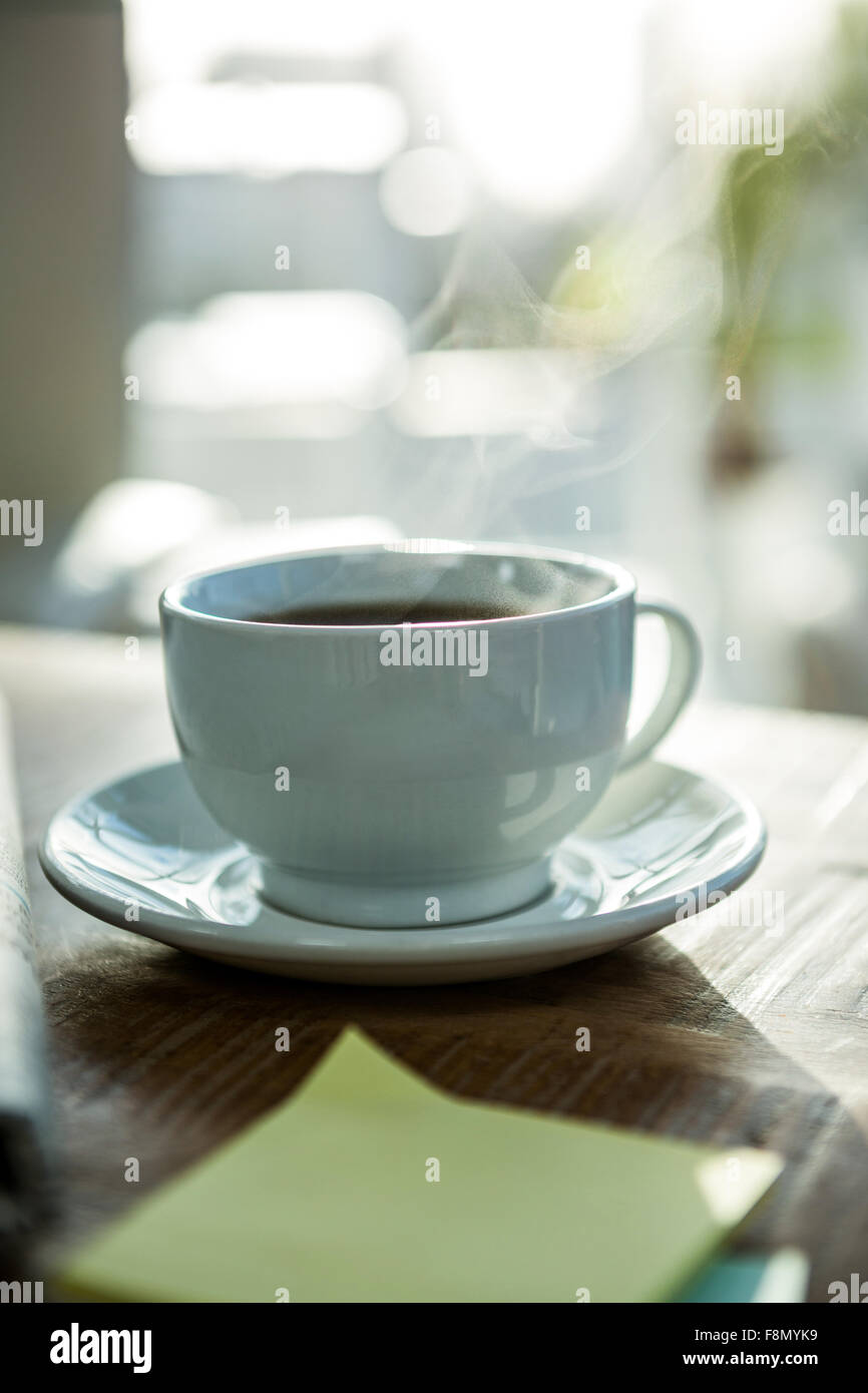 Steaming cup of coffee - Stock Image