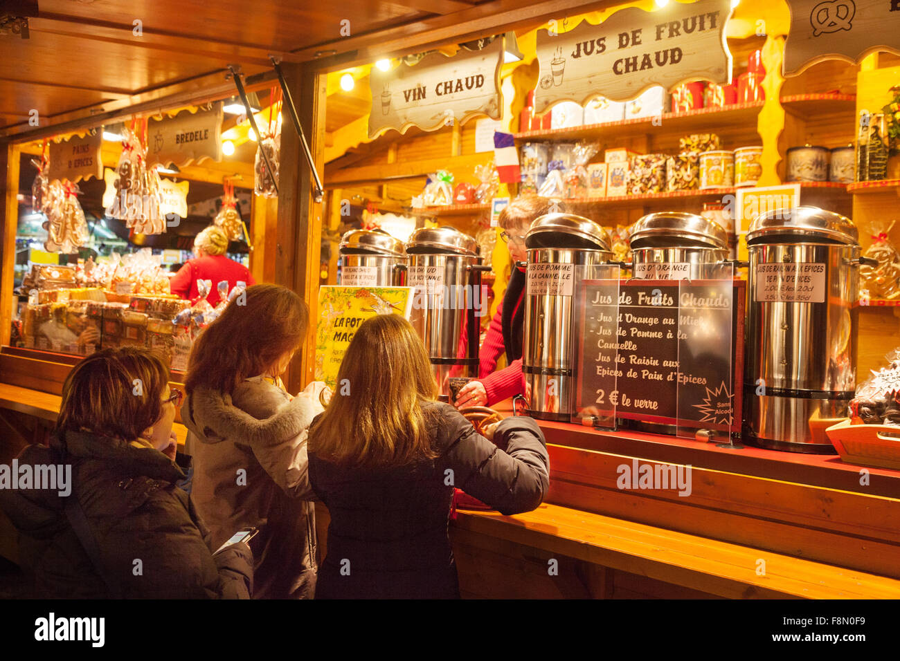 Mulled Wine Christmas Market.Women Buying Vin Chaud Mulled Wine At A Stall