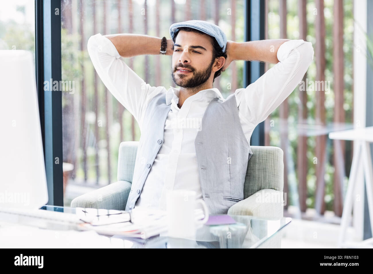 Handsome man looking at computer monitor - Stock Image
