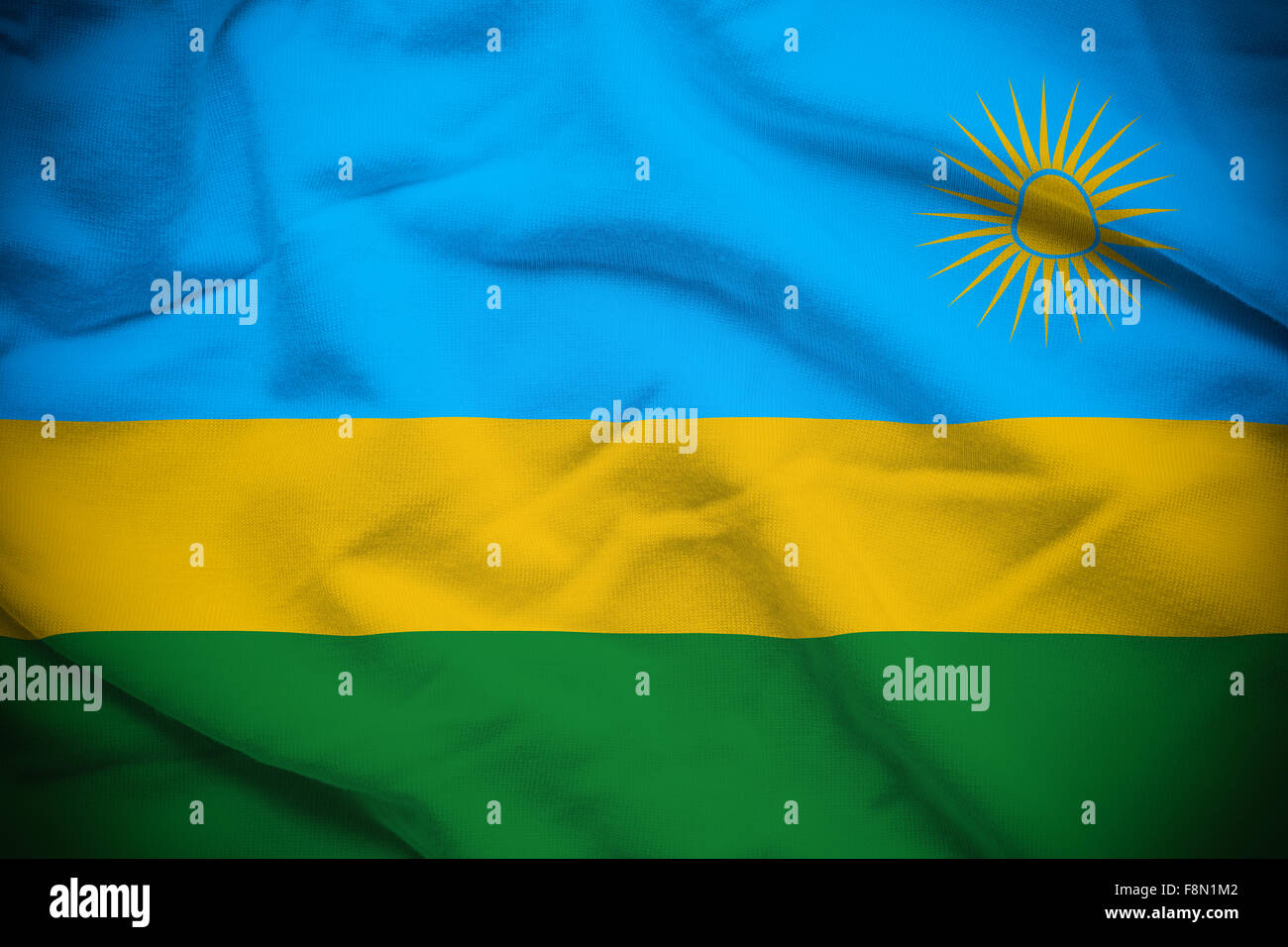 Wavy and rippled national flag of Rwanda background. Stock Photo