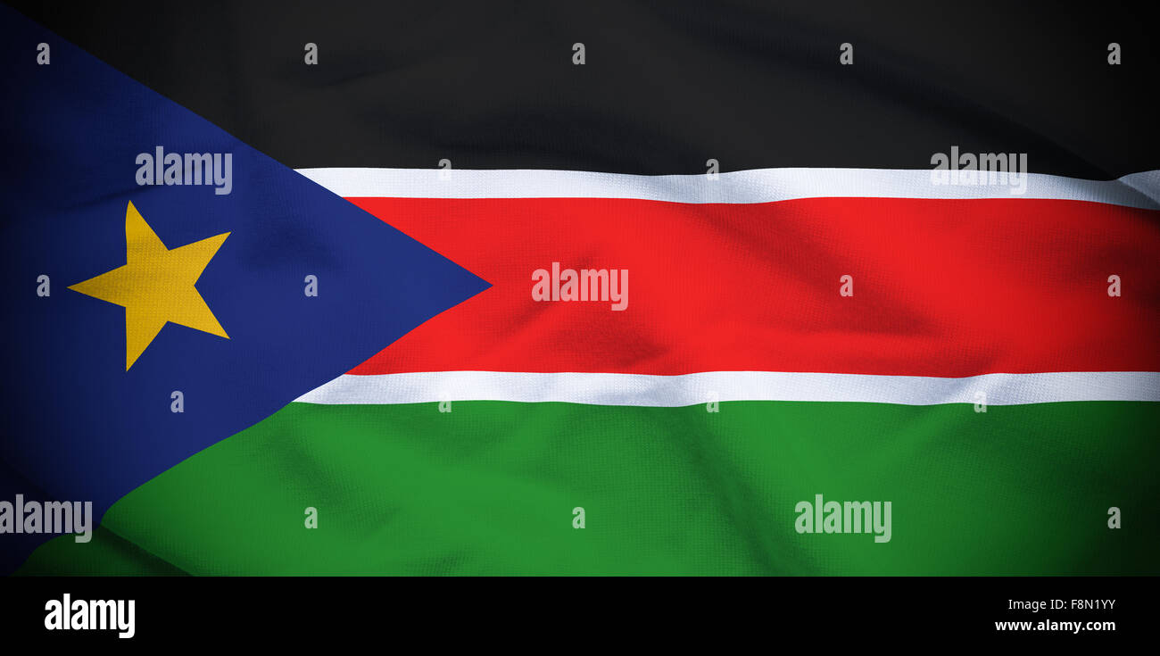 Wavy and rippled national flag of South Sudan background. - Stock Image