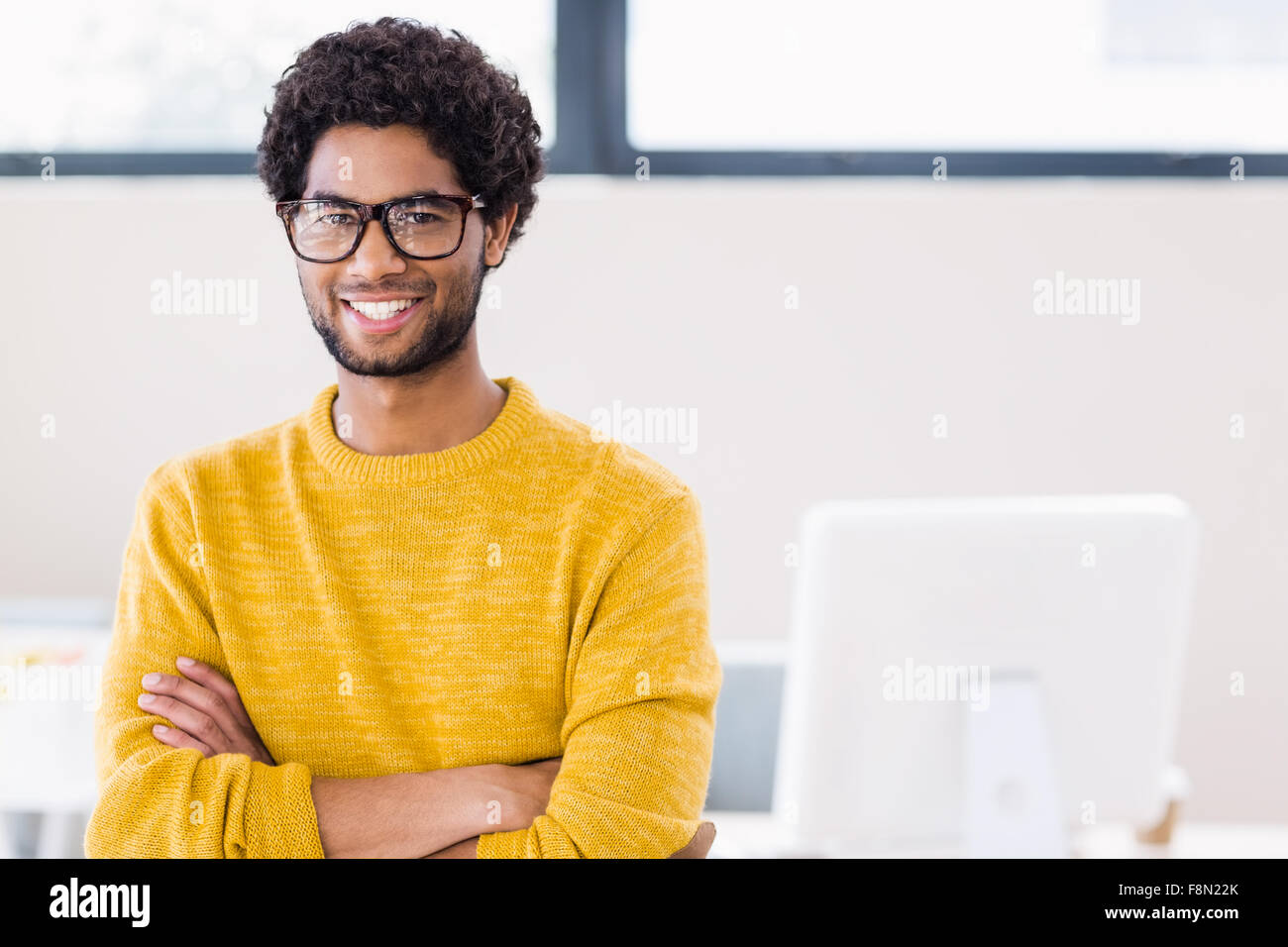 Portrait of attractive man smiling at camera - Stock Image
