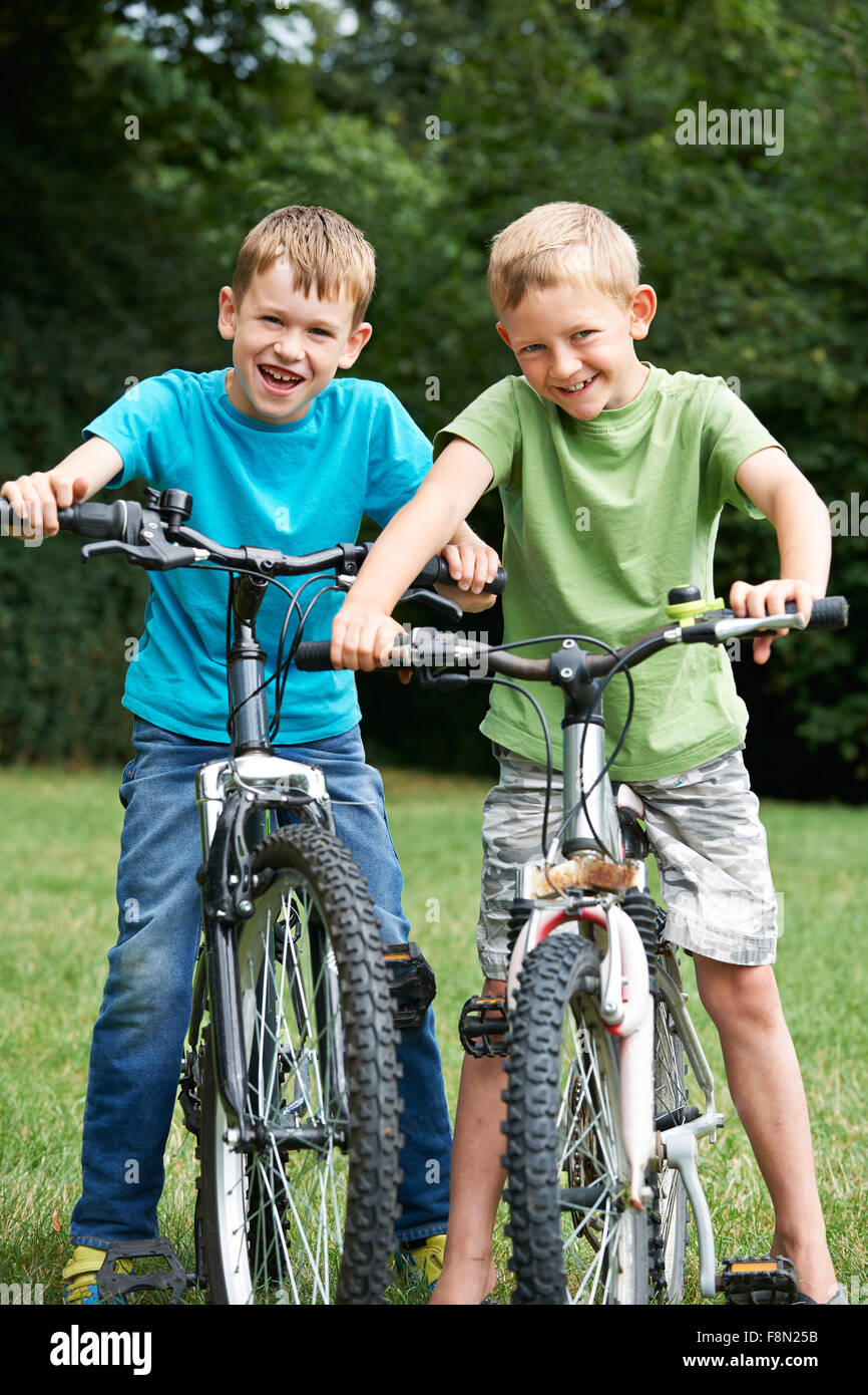 Two Boys Riding Bikes Together - Stock Image