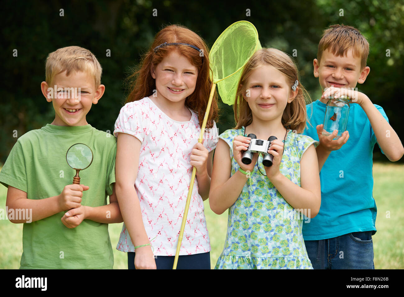 Group Of Children Exploring Nature Together - Stock Image