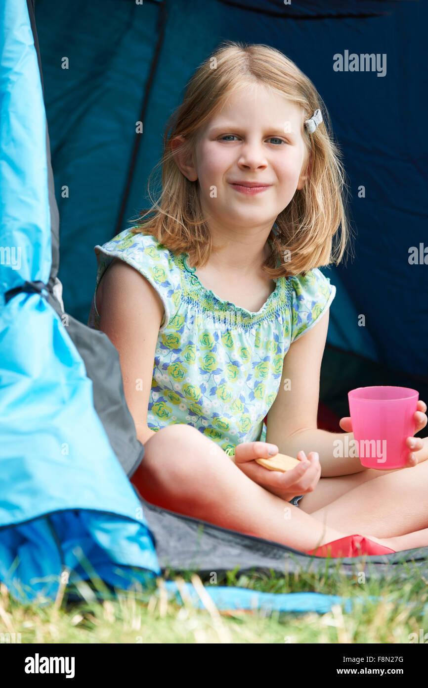 Girl Having Snack On Camping Trip - Stock Image
