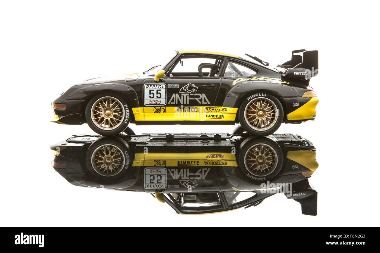 Scale Model  Porsche 911 Turbo in race trim on a white background - Stock Image