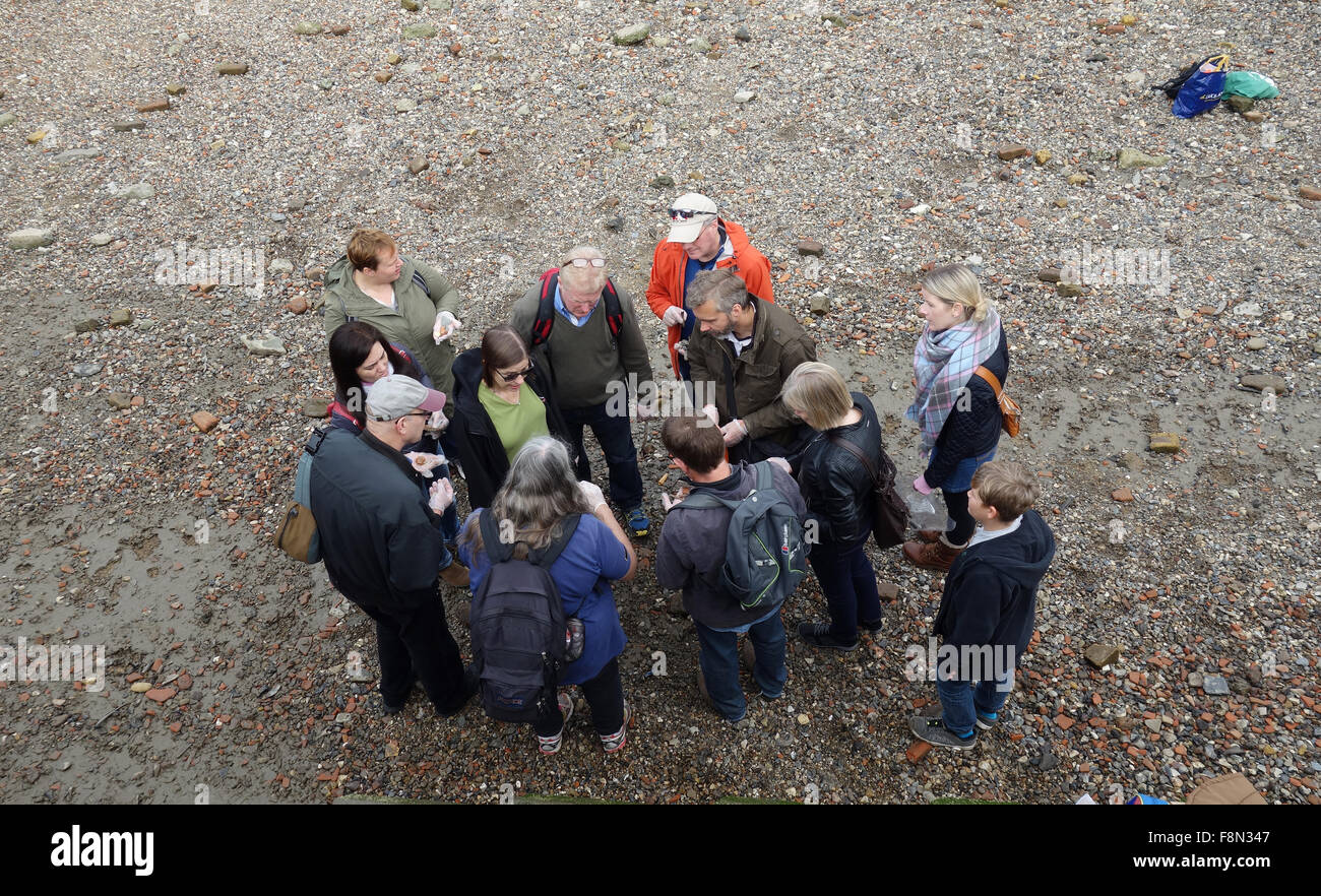 Group of mudlarks on foreshore of River Thames, London Stock Photo