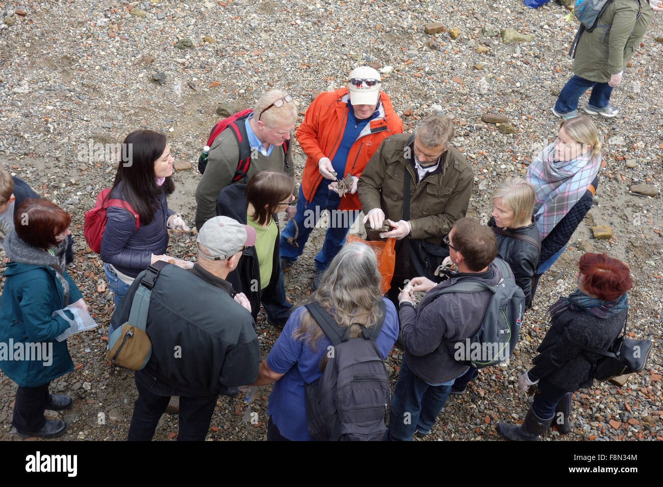 Group of mudlarks on foreshore of River Thames, London Stock Photo
