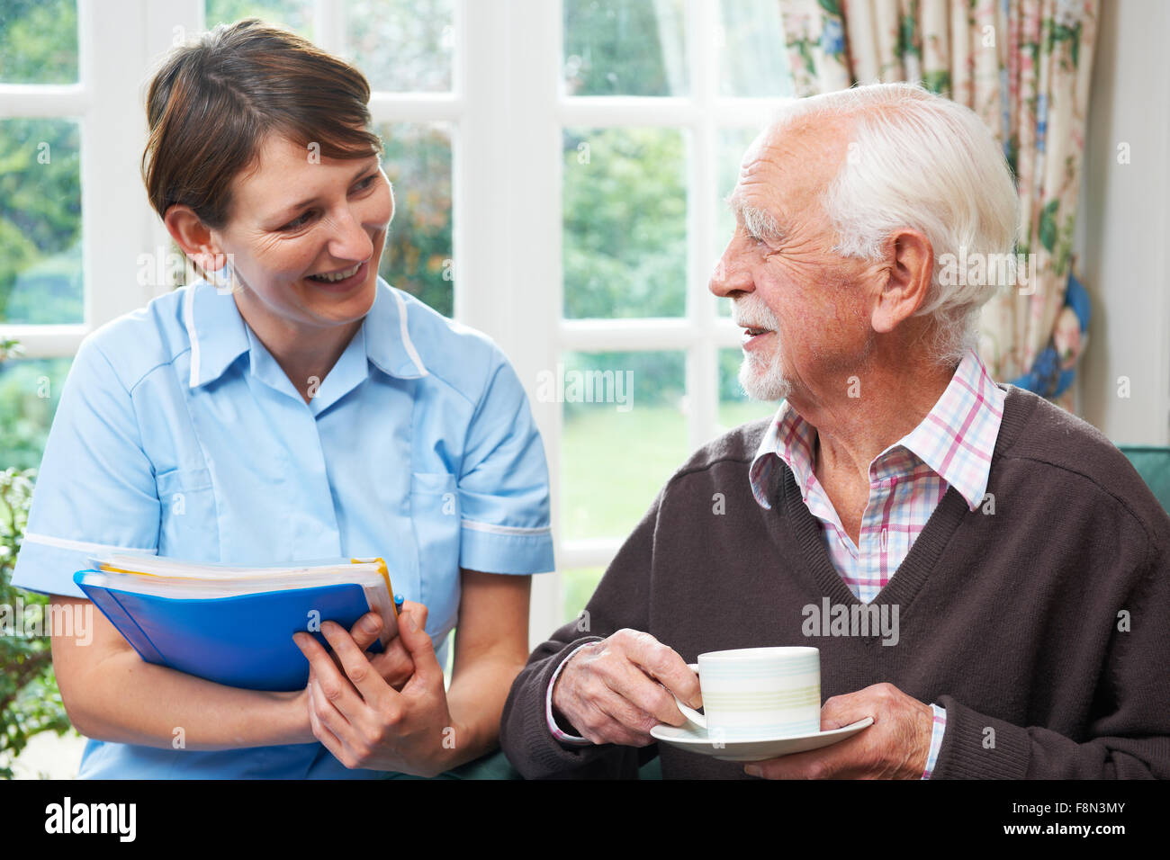 Senior man With Carer At Home - Stock Image