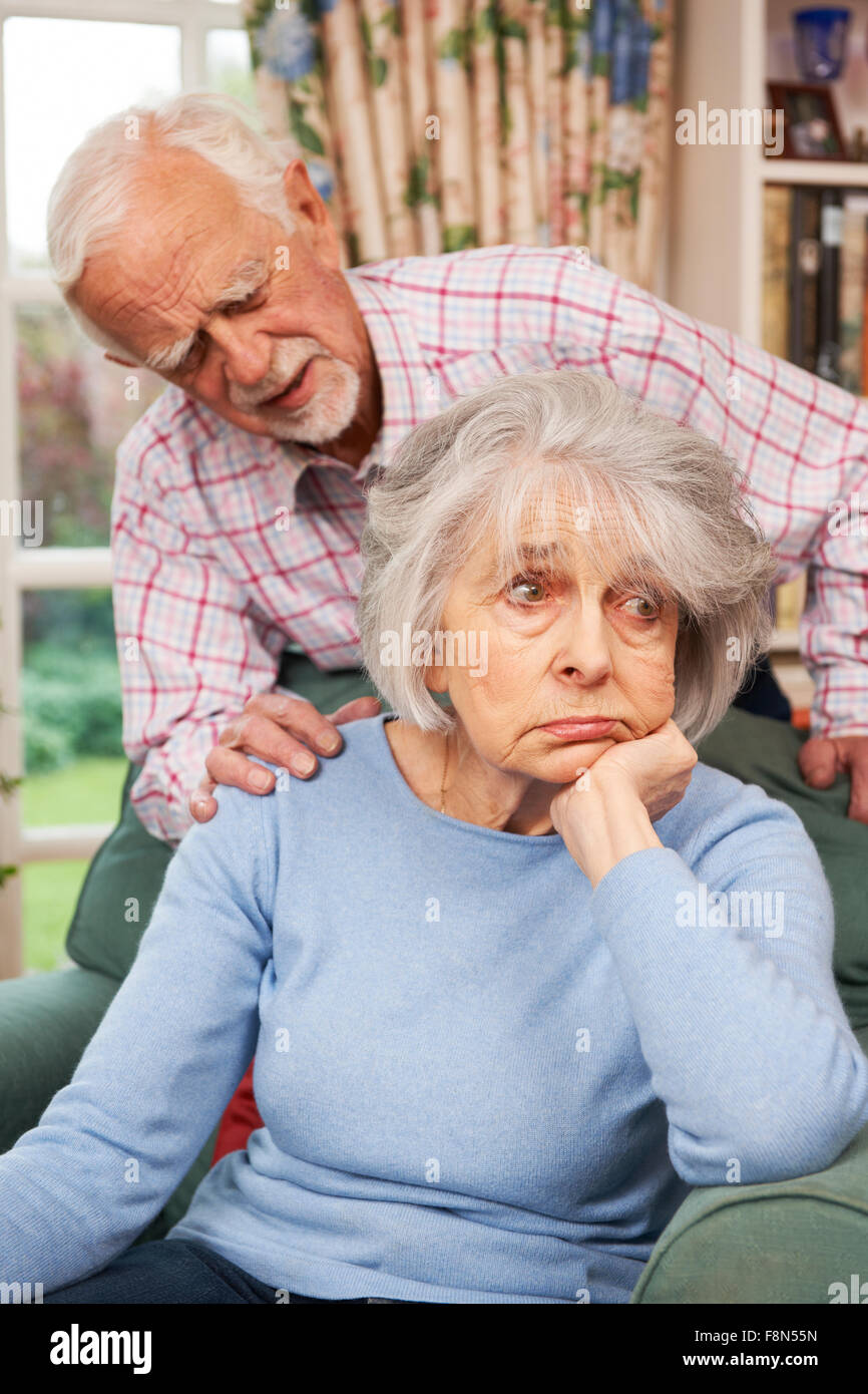 Man Comforting Senior Woman With Depression Stock Photo