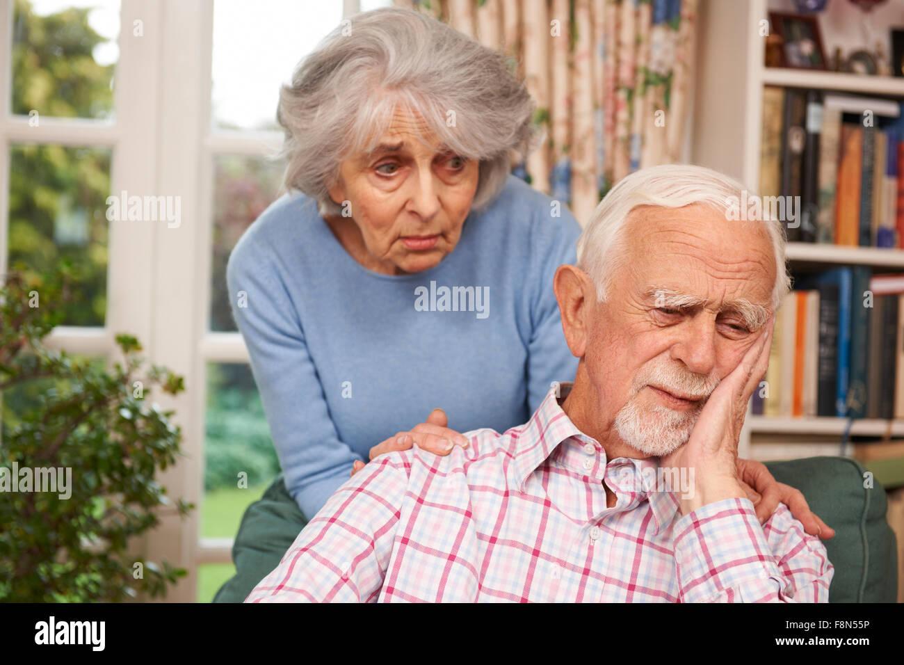 Woman Comforting Senior Man With Depression - Stock Image