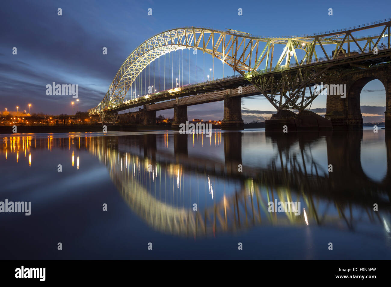 The Runcorn and Widnes Roadbridge crossing the River Mersey at Night, Cheshire, England - Stock Image
