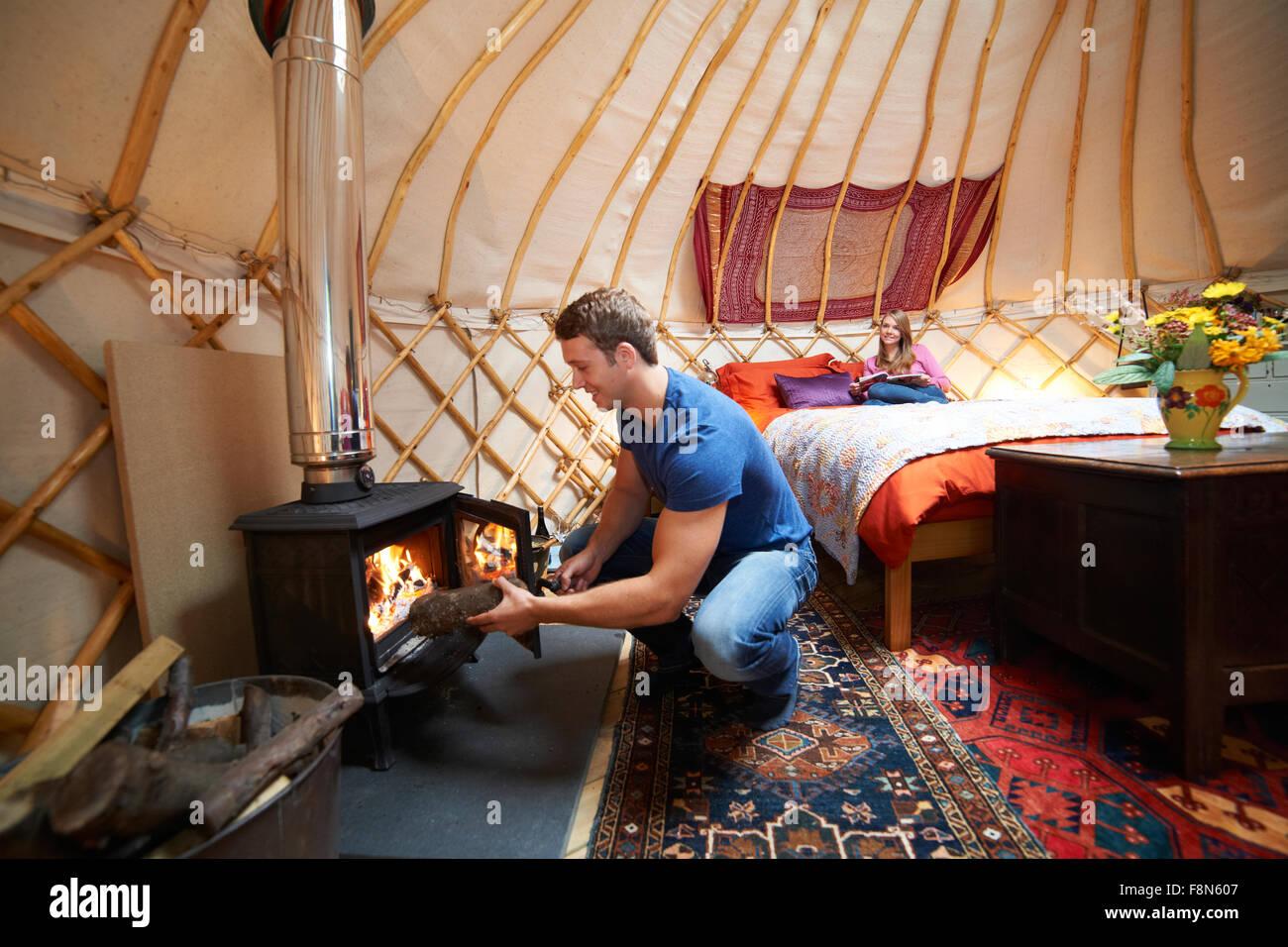 Couple Enjoying Luxury Camping Holiday In Yurt - Stock Image