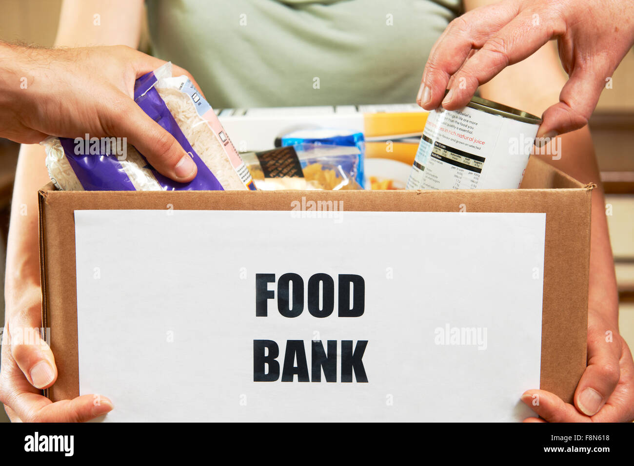 Making Donations To Food Bank - Stock Image