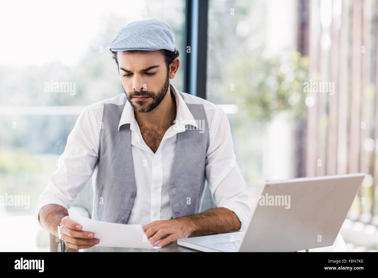 Focused man looking at document - Stock Image