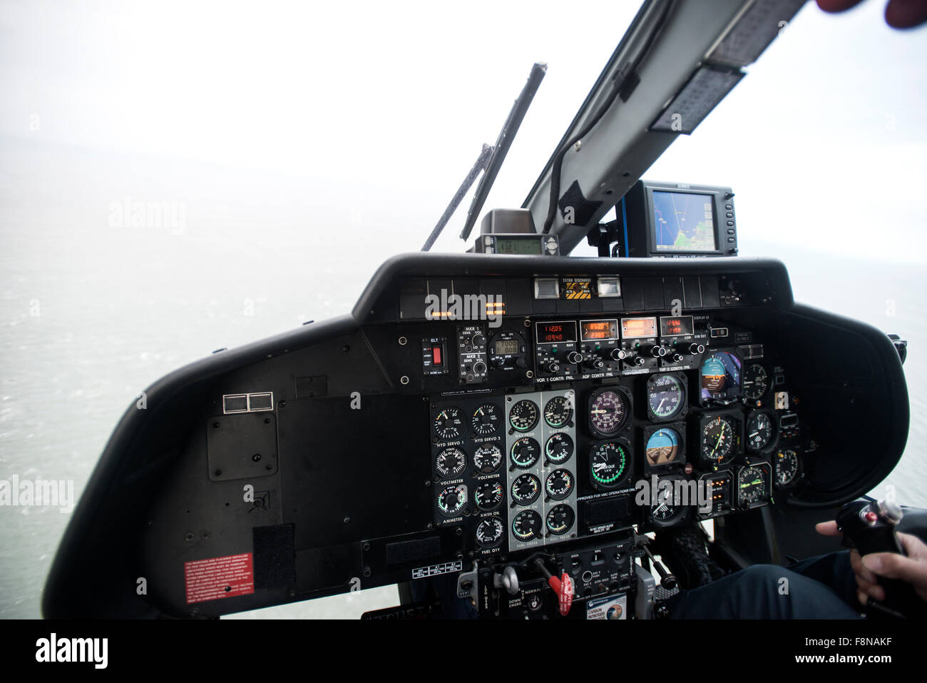 in the cockpit of a helicopter flying from the mainland to Lundy Island - Stock Image
