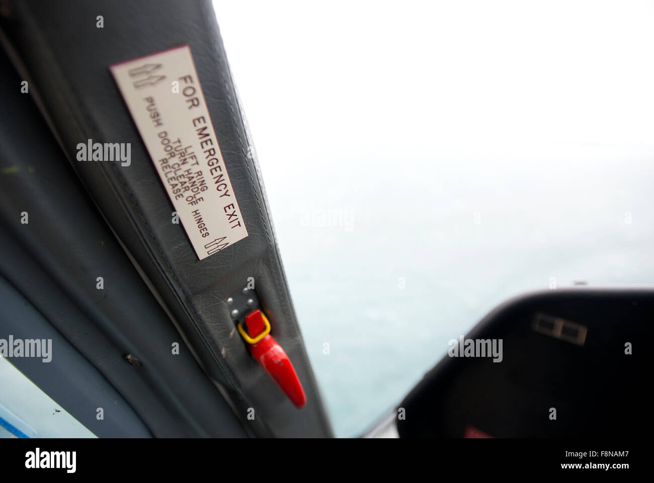 Emergency exit in a helicopter cockpit, on the shuttle flight to Lundy Island - Stock Image