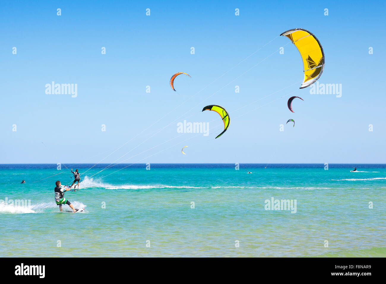 Canary Islands, Fuerteventura Island, kitesurfing at the beach near Costa Calma, Spain - Stock Image