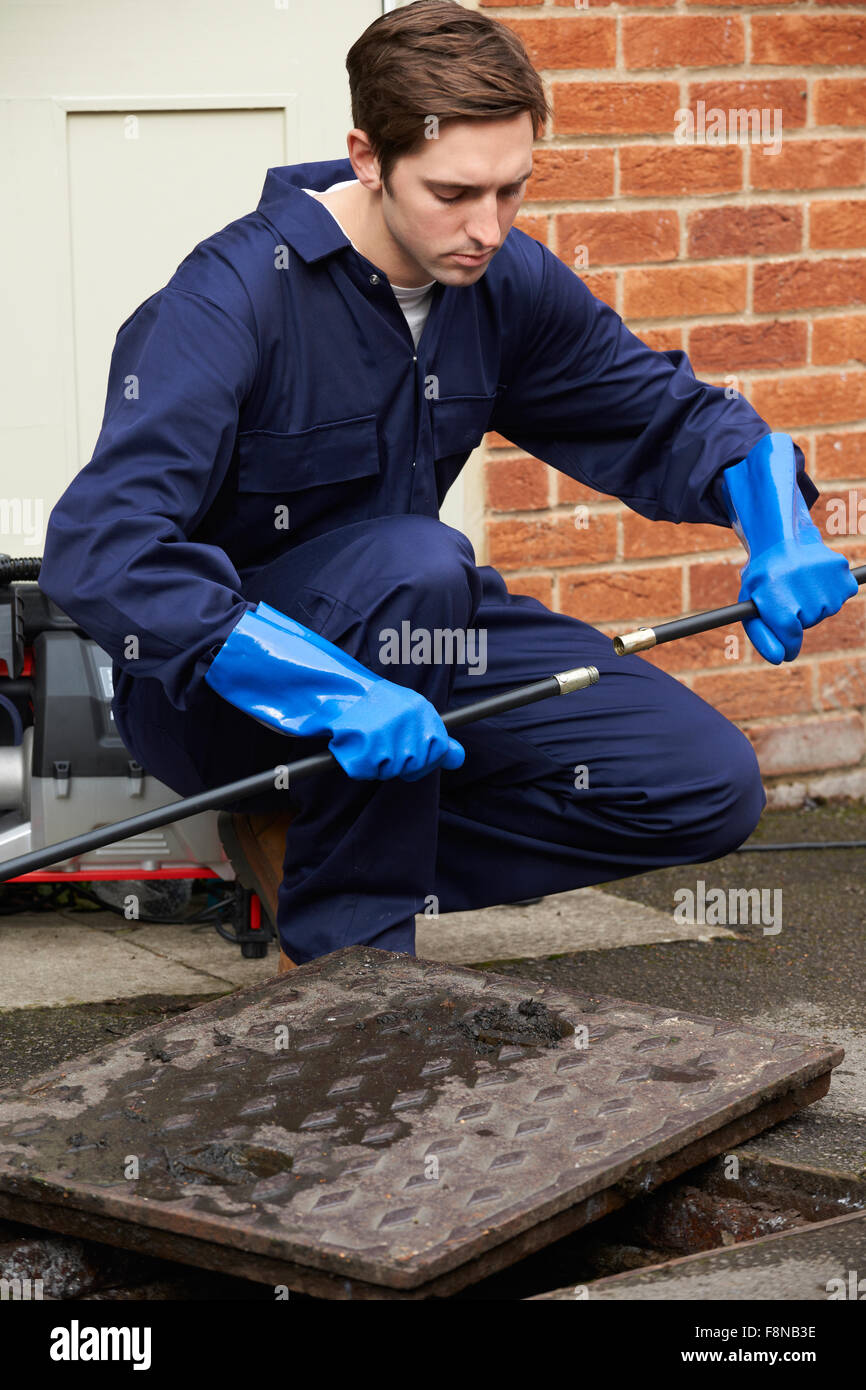 Plumber Fixing Problem With Drains - Stock Image