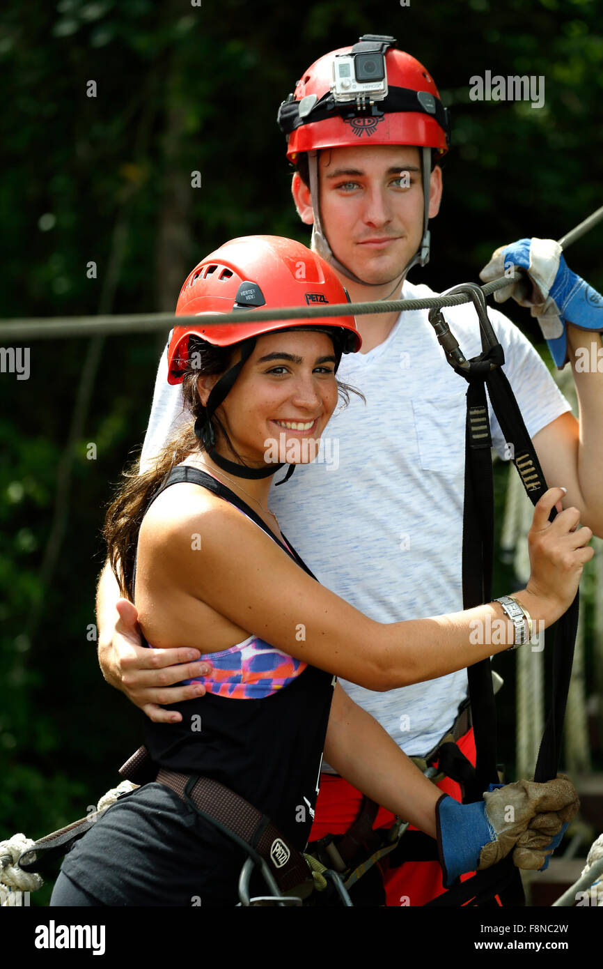 Couple on suspended canopy bridge, Ecoquest Adventures & Tours, Hacienda Campo Rico, Carolina, Puerto Rico - Stock Image