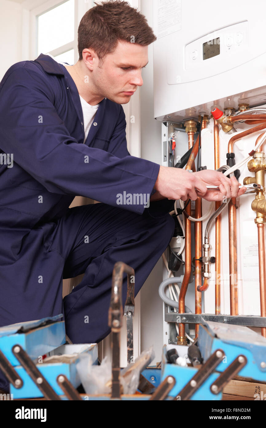 Engineer Servicing Central Heating Boiler - Stock Image