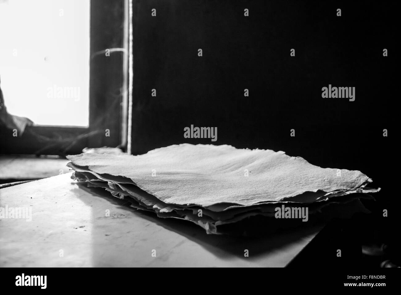 Ancient paper mill. Old traditional process of paper production - Stock Image