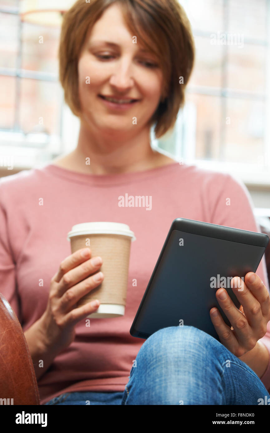 Woman With E-Book Reader In Cafe - Stock Image