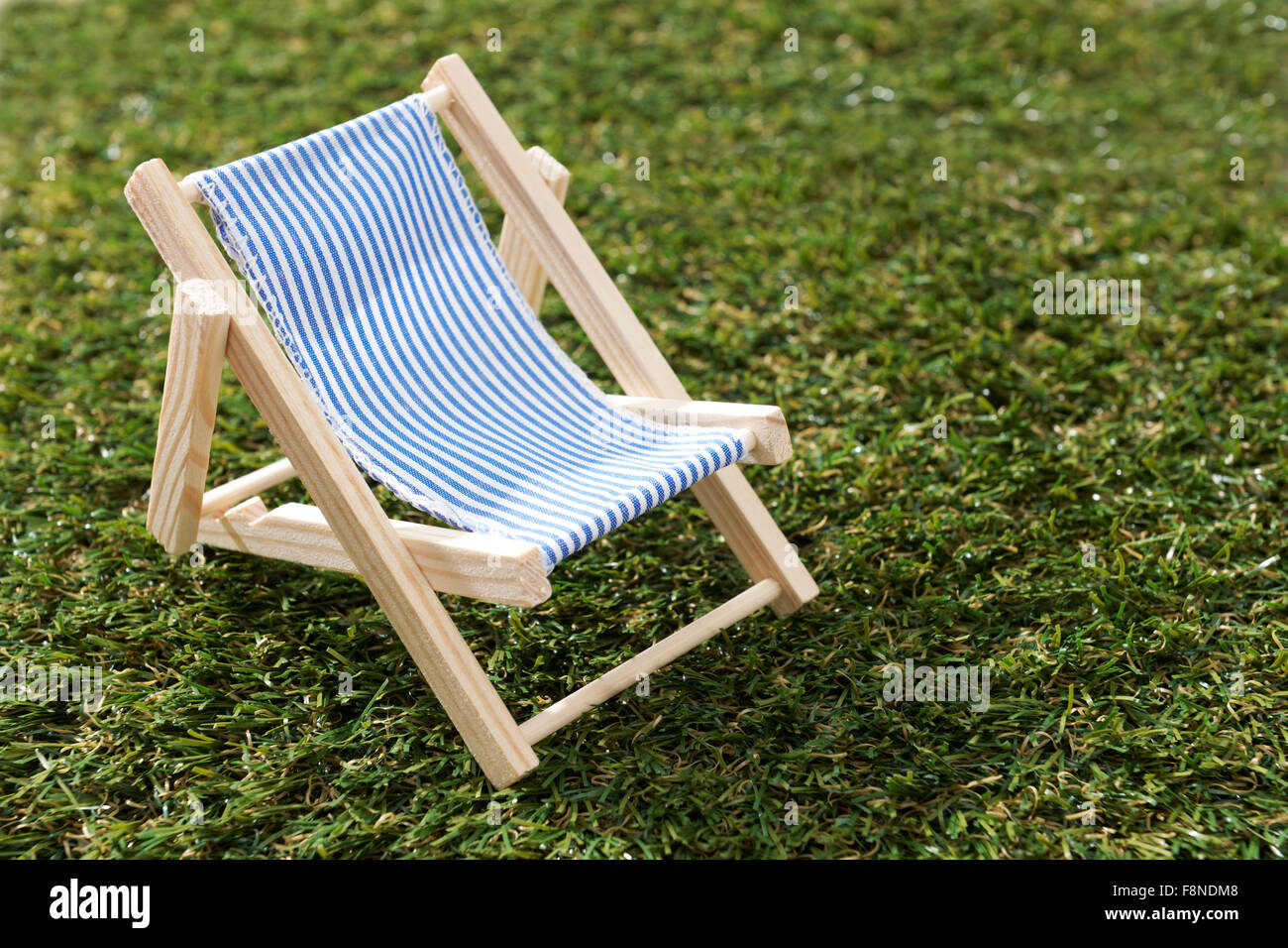 Model Deck Chair On Grass - Stock Image