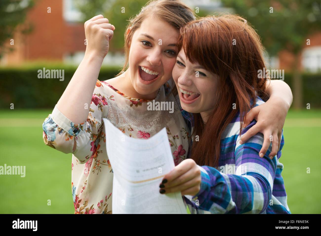 Teenage Girls Celebrating Good Exam Result - Stock Image